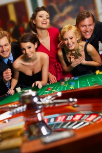 Two Couples Playing At A Casino